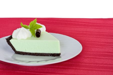 a light and delicious mint cream pie on chocolate crumb crust. garnished with whipped cream, chocolate curl and fresh mint Foto de archivo