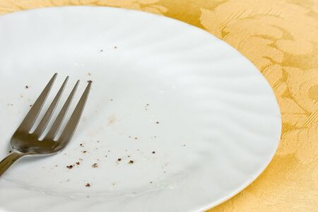 the pie has been eaten and only a few crumbs remain on the dirty plate with the fork Stock Photo - 5162346