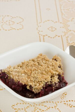 tasty home-made blueberry crisp in bowl Stock Photo