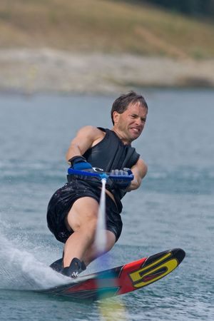 ABBOTSFORD, BC - AUGUST 4, 2009: Robert Lounsbury from the Coos Bay Police Dept in Oregon competes in the men's slalom novice waterskiing at the World Police and Fire games Editorial
