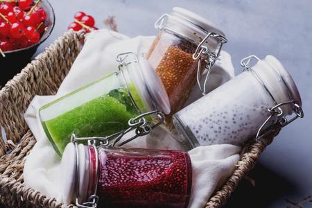 Clean eating snacks: take away chia smoothies. Berry chia smoothie, spinach and apple smoothie, yogurt smoothie