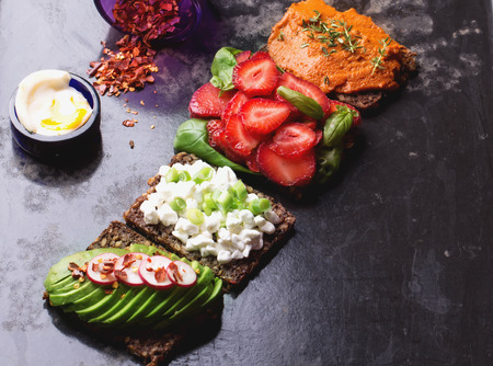 raddish: Open sandwich: cottage cheese with green onion, red pesto from bell peppers with thymian, avocado with raddish and chili flakes and strawberry basil with soft boiled egg and chili flakes