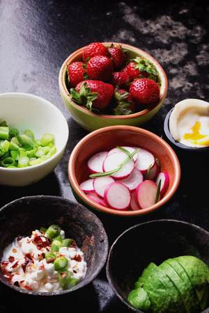 pepper flakes: Ingredients for the open sandwich: avocado, cottage cheese, green onion radish, strawberry,  soft boiled egg, sea salt and chili pepper flakes