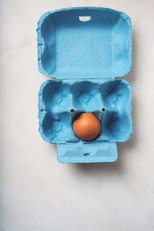 Eggs in the blue egg box. Minimalist food concept. Flat  Lay. Top View. Standard-Bild