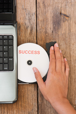 dvds: Success concept with compact disk and laptop