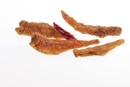 anchovy with chili on white background photo
