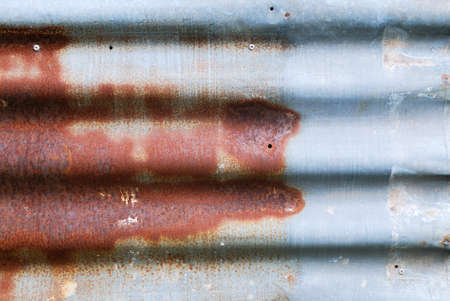 Grunge wall background with sags of rust photo