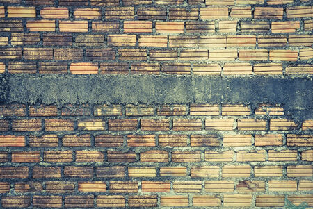 old cracked vintage brick wall background photo