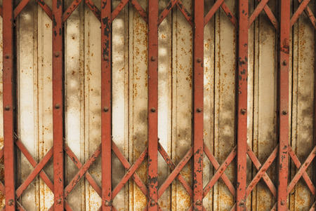 Old Metal Folding Door  with rusty and scratches close up photo