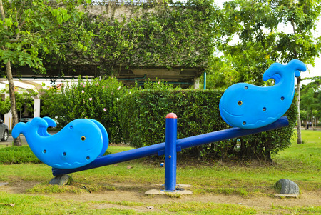 Blue seesaw on a children playground Stock Photo