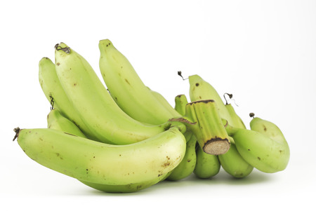 Bunch of green bananas on white background photo