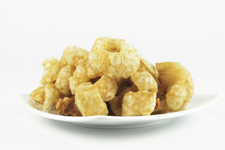 rinds: Pork rinds also known as chicharon or chicharrones, deep fried pork skin