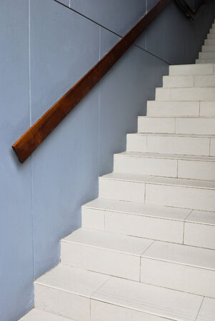 Blank stairways with wood railing Stairway to the dark photo