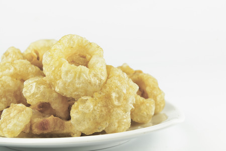 chicharon: Pork rinds also known as chicharon or chicharrones, deep fried pork skin