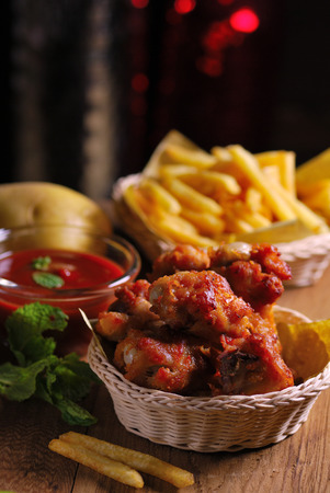 fried chicken wings with french fries and ketchup photo