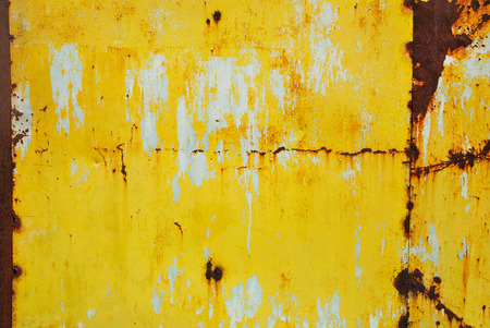 Yellow painted metal with rust texture