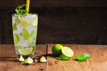 Mojito , lime pieces , leaves of mint with ice and rum photo