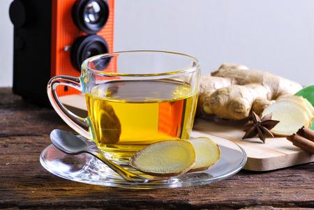 Ginger tea on wood table backdrop photo