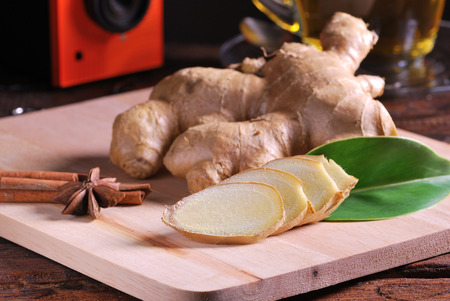Ginger sliced on chop board wood table photo
