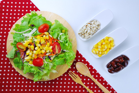 Fresh vegetable salad with corn,carrot,tomato,green oak,red oak,Red bean and millet photo