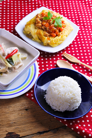 Rice ,stuffed omelette and tom kha kai ,chicken with coconut milk soup. photo