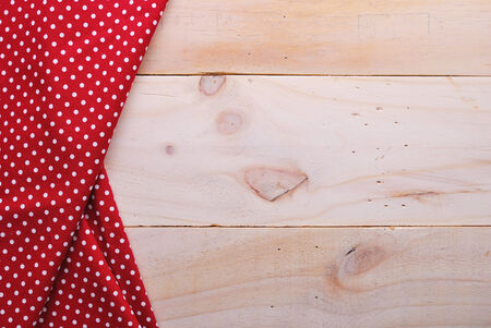 the background made from tablecloth on wooden table photo