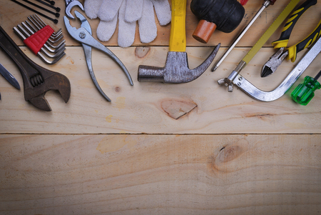 row house: tool renovation on  wood plank table