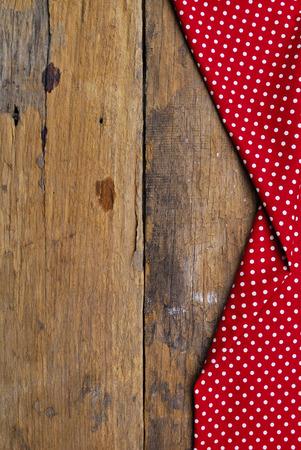 De achtergrond gemaakt van tafelkleed op oude houten tafel Stockfoto