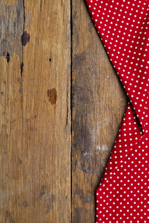 The background made from tablecloth on old wooden table Stock Photo