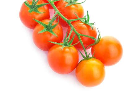 Closeup of cherry tomatoes on the vine photo