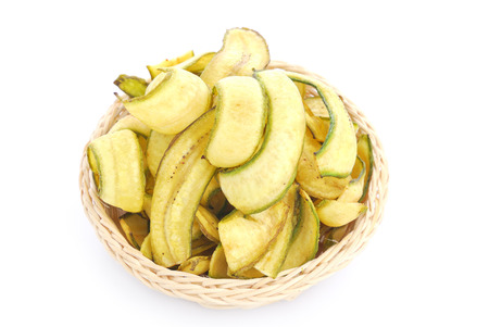 Banana crisp , fried thinly sliced banana chips, a tropical snack photo