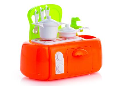 Miniatuur Keuken Teller op een witte achtergrond Stockfoto