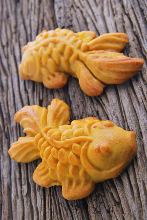 moon fish: Moon cake in gold fish shape  or Chinese cake mung bean
