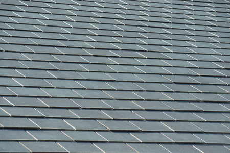 bad economy: horizontal picture of slates on a roof Stock Photo