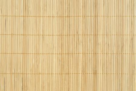 Bamboe bruin stro mat als abstracte textuur achtergrond samenstelling, bovenaanzicht boven