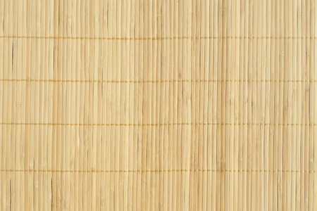 Bamboo brown straw mat as abstract texture background composition, top view above Standard-Bild