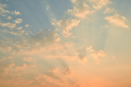 sunset sky with clouds  and golden light photo