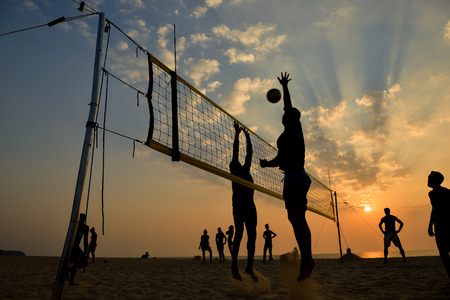 volleyball team: Beach volleyball silhouette at sunset , motion blurred Stock Photo