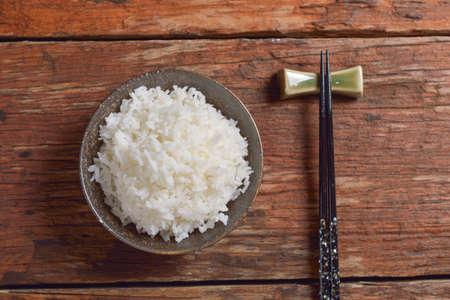chop sticks: Bowl of Organic White Rice with chop sticks
