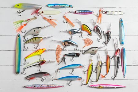 fishing catches: Colorful Fishing Lures on wood desk Stock Photo