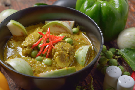 favorite soup: Thai chicken green curry with old wooden background Stock Photo