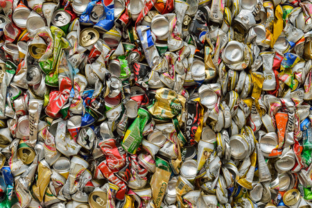crushed aluminum cans: PHUKET, THAILAND JUNE 28, 2015 :Recycled aluminum beverage cans from various brands of drinks. The cans will be shipped to an aluminum foundry