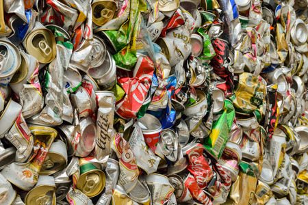 crushed cans: PHUKET, THAILAND JUNE 28, 2015 :Recycled aluminum beverage cans from various brands of drinks. The cans will be shipped to an aluminum foundry