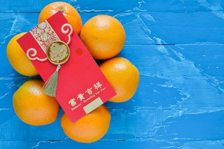 greeting season: Chinese New Year Decorations orange and red envelope (Foreign text means spring season greeting)