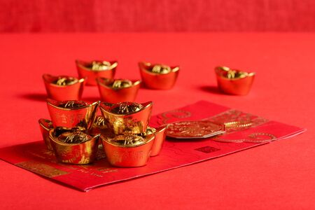 ingots: Chinese red pockets and ancient Chinese golden ingots