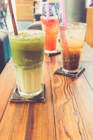 tea filter: Iced green tea latte and other drinks in coffee shop retro filter