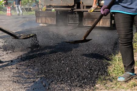 vibration machine: Worker operating asphalt paver machine during road construction and repairing works focus on asphalt road