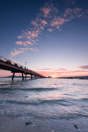 Bridge to the sea at sunrise, chalong harbor Phuket Thailand, long exposure