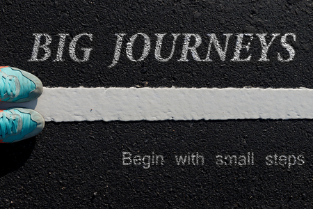 to move forward: Inspiration quote :  Big journeys begin with small steps  on aerial view of running shoe  on road with move forward yellow arrow ,Motivational typographic.