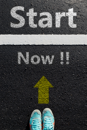 to move forward: Inspiration quote :  Start now on aerial view of running shoe  on road with move forward yellow arrow ,Motivational typographic.
